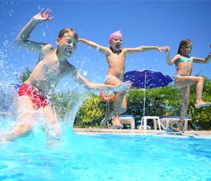 Kids jumping in Carolina Beach swimming pool